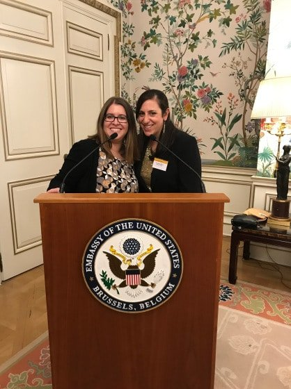 Rachel Gordon posing at the US Embassy in Brussels with a colleague during her professional development abroad program